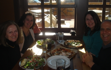 Enjoying a delicious meal, left to right Faye Shealy, Elizabeth Cavallari, Rhianna Shabsin, and Paul Marcus.