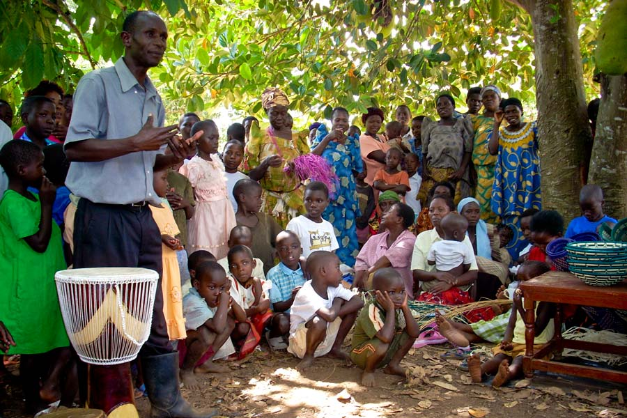 The Luguzi village leader addresses local residents after Bunch '06 and Smith '06 presented a drum as a gift to the community. The village leader urged everyone to help build the school in Buwasa.